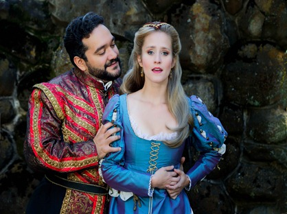 IN PERFORMANCE: Tenor RENÉ BARBERA as il Duca di Mantova (left) and soprano AMY MAPLES as Gilda (right) in Piedmont Opera's production of Giuseppe Verdi's RIGOLETTO, October 2015 [Photo © by Christina Holcomb Photography, LLC; used with permission]