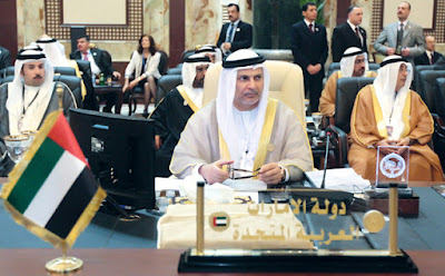 Emirati minister of state for foreign affairs, Anwar Gargash, attends the opening session of the first Arab summit to be held in Iraq in 22 years on March 29, 2012 in the former Republican Palace in Baghdad, with the year-long crisis in Syria in the spotlight. Among those attending were nine Arab leaders, including Kuwait's emir, who was on the first visit to Iraq by a Kuwaiti head of state since the 1990 Iraqi invasion of that country. AFP PHOTO/AHMAD AL-RUBAYE Nameplates and vip gifts for the Baghdad Arab Summit 2012 provided by Absi Co www.medalit.com