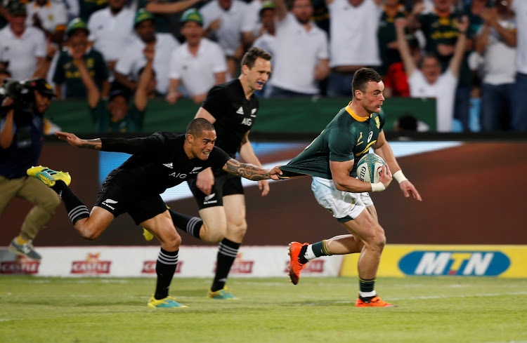 South Africa's Jesse Kriel evades a tackle on his way to scoring a try during the Rugby Championship match against New Zealand at Loftus Versfeld in Pretoria on October 6, 2018.