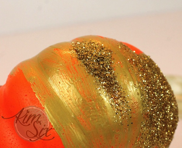 Painting and adding glitter to pumpkin