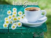 buon giovedi immagine con frase aforismo tazza margherite fiori.jpg