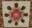 Here a combination of echoing and a simple jigsaw meander have been added to this rosebud block