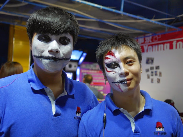 Two City Hero employees with Halloween face paint in Shaoguan