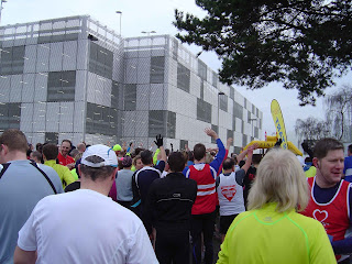 The runners line up just before the start