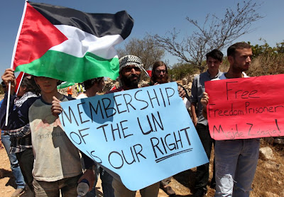 Palestinians attend a demonstration in the West Bank village of Beit Omar for a seat at the United Nations.