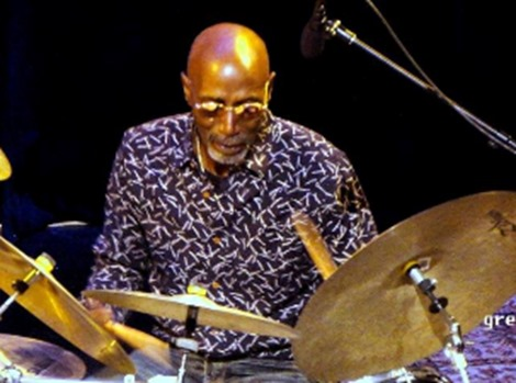 TS Monk behind drums; photo courtesy of artist