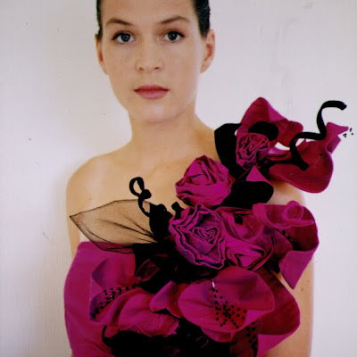 Thai Silk Evening gown, with a cascade of hand-made flowers. This gown was a finalist in the Benson & Hedges Fashion awards, and Supreme winner of a Bay Of Plenty Fashion Design competition in 1993.