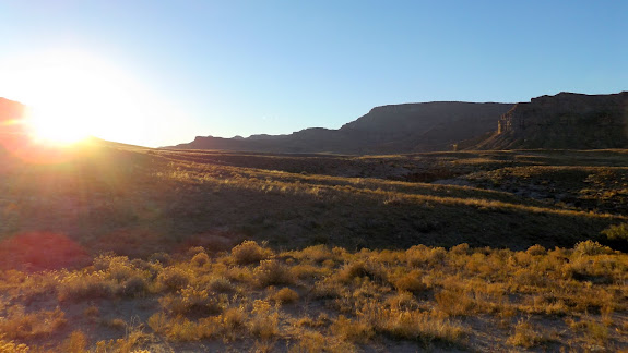 Setting sun above Tusher Canyon