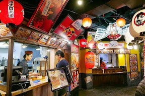 Namja Town has an area that is their Gyoza Stadium with a dozen little booths of different pot stickers, or gyoza, to try. You can get them for here or to go in little boxes you can collect in a basket so you can sample from multiple booths and try different styles
