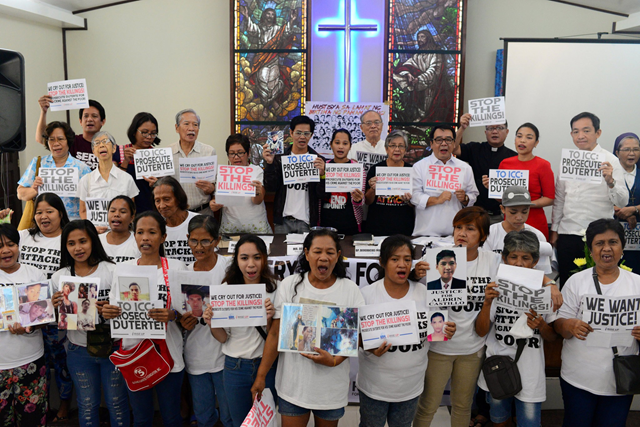 Relatives of Filipinos murdered by the government in the Philippine drug war, along with activists, at a protest on Tuesday, 28 August 2018, in the Manila area. Photo: Eloisa Lopez / Reuters