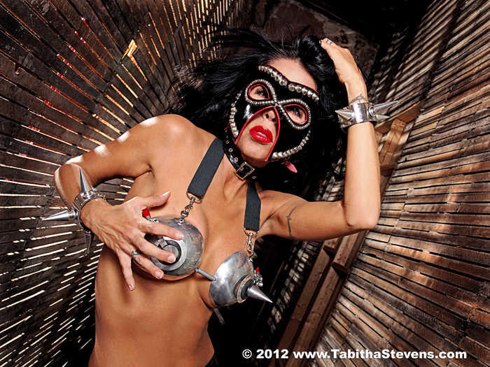 Photo: Tabitha Stevens in metal spikey breast plate as in Heavy Metal or from a Sci-Fi movie as photographed by Gary Orona.