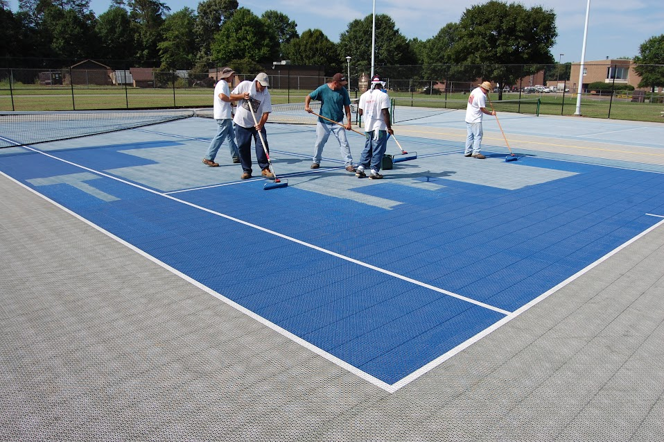 Recreation Department Paints Tennis Courts At Freedom Park