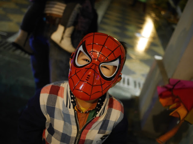 little boy wearing a Spiderman Halloween mask in Shaoguan, China