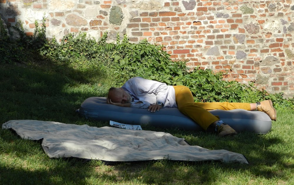 a bum sleeping beside the Cathedral walls
