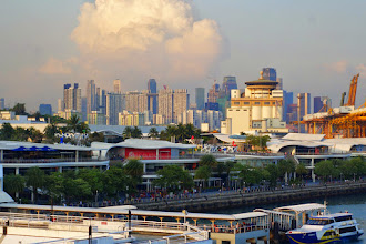 Photo: Singapore at dusk from the fantail