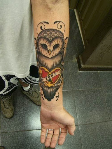 Owl tattooson arm in the memory of someone