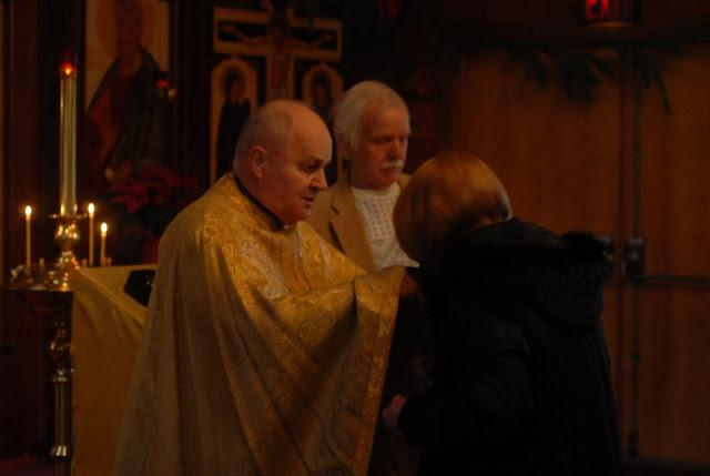 Fr. Joseph greets parishioners after the Liturgy.