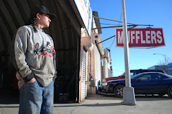 A mechanic waits for customers on an early February morning in Willets Point.