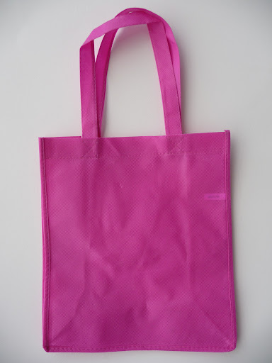 I love these reusable totes, but I seem to have a lot already.  I had to find a good use for this bright pink bag.