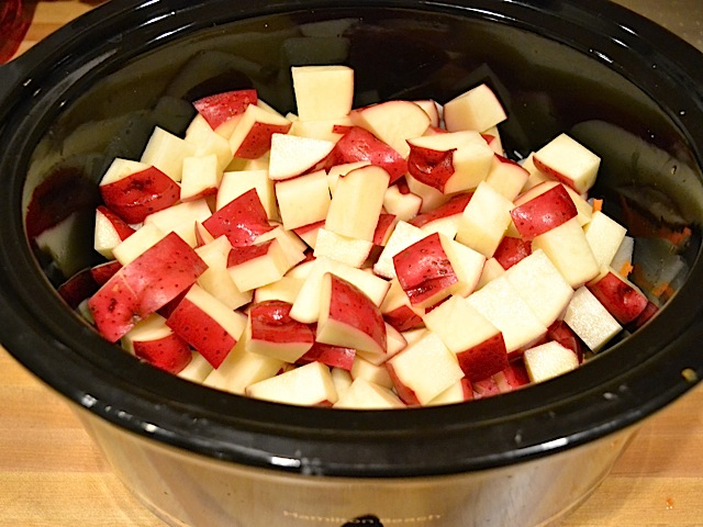 cubed potatoes in slow cooker with other vegetables