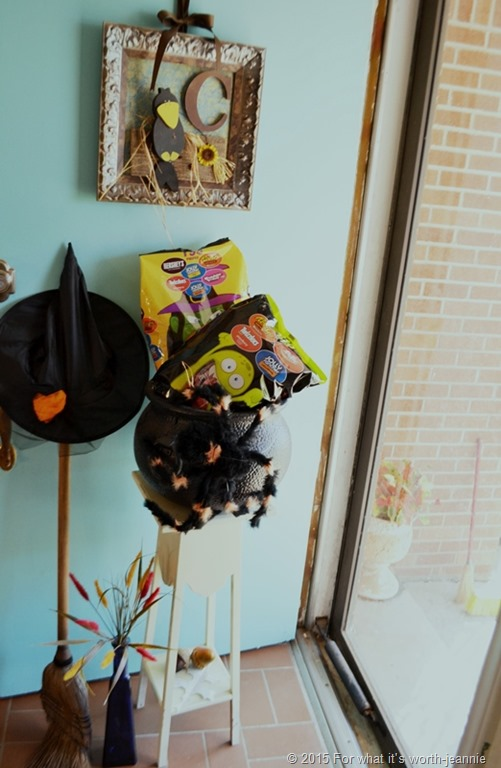 witch hat, broom and cauldron of candy with spider