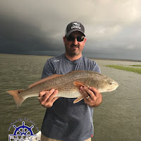 Flynn with a top of the slot Apalachicola Redfish 05-15-2018