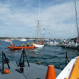 Poole ILB and ALB responding to an incident where two yachts had their anchors entangled. The ILB crew unshackled one of the anchors so that they could untangle the anchors. 1 September 2013 Photo: RNLI/Poole