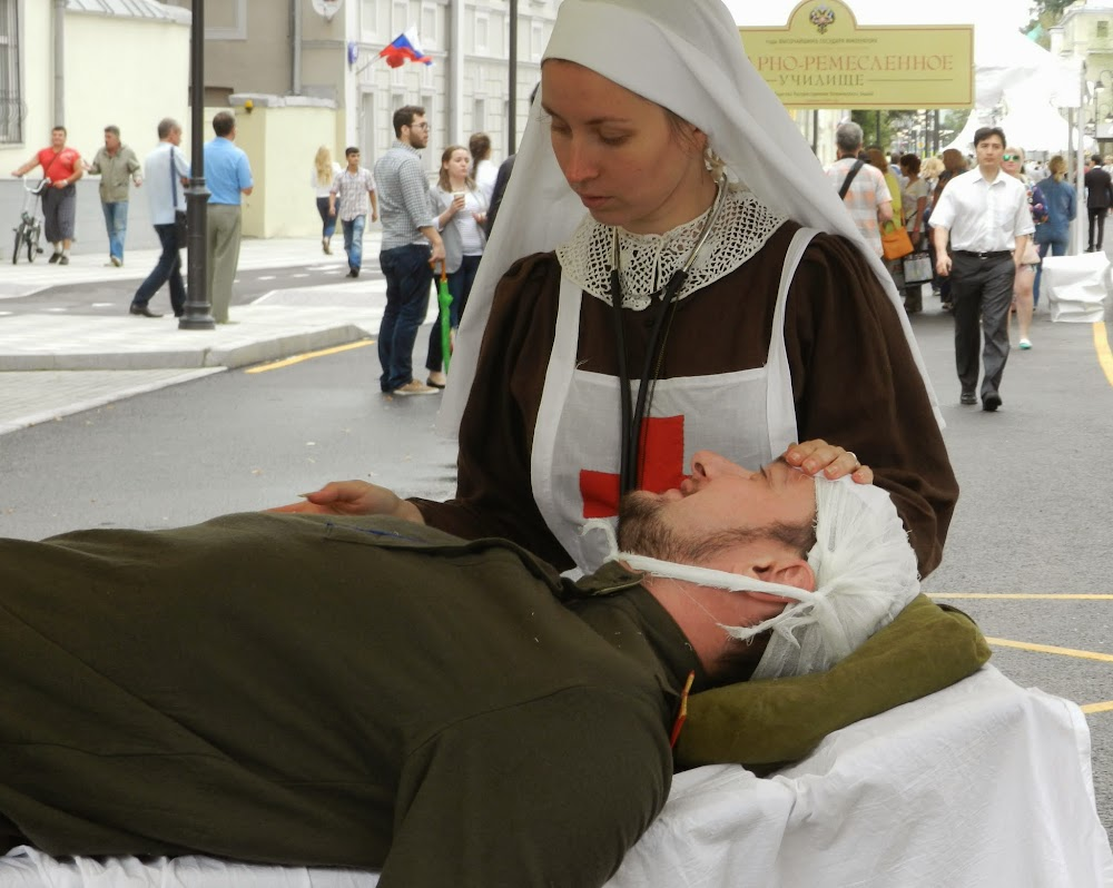 scene of a nurse tending to a wounded soldier