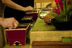 at altar, hands picking up incense.jpg