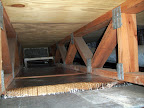 Condo Basement Crawl Space, Large Trusses using Foil to create air barrier to 1st Floor Above.