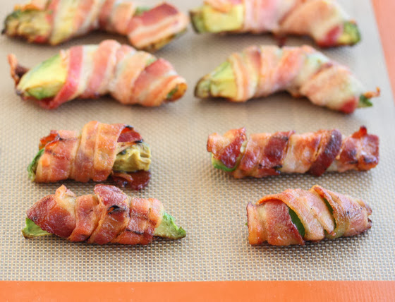 photo of cooked bacon wrapped avocado fries on a baking sheet