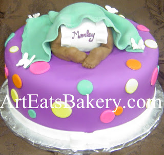 Custom unique purple, green, yellow, orange and pink polka dot fondant baby under a blanket shower cake