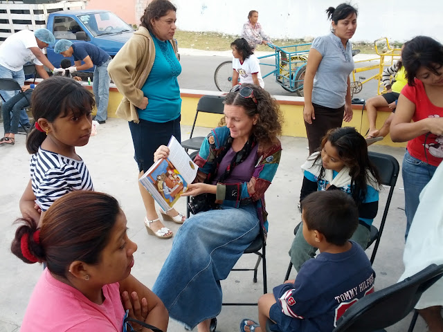 Kelly sharing a story with the kids.