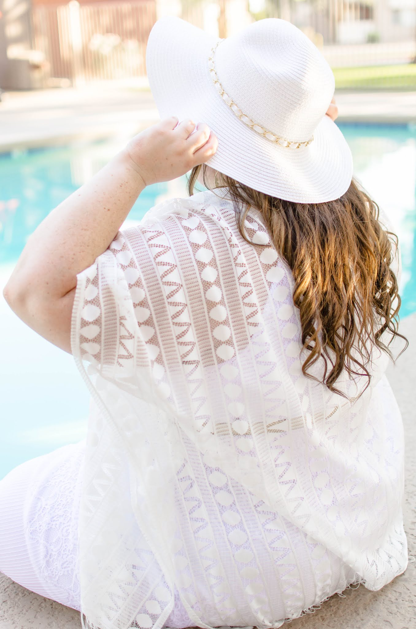 plus size woman in all white beach sunwear and sunht