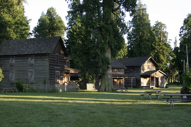 Pioneer Park, a 25 acre park located on the banks of the Nooksack River, features a children's play area, mature cedar trees, picnic shelters, softball fields and stage, plus represents one of the finest collections of original pioneer log cabins and artifacts.Credit: Peter James