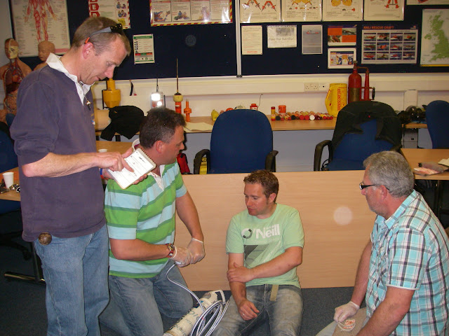Casualty Care for Lifeboat Crew course – April 2011: crew assessing casualty and asking about the history of the incident