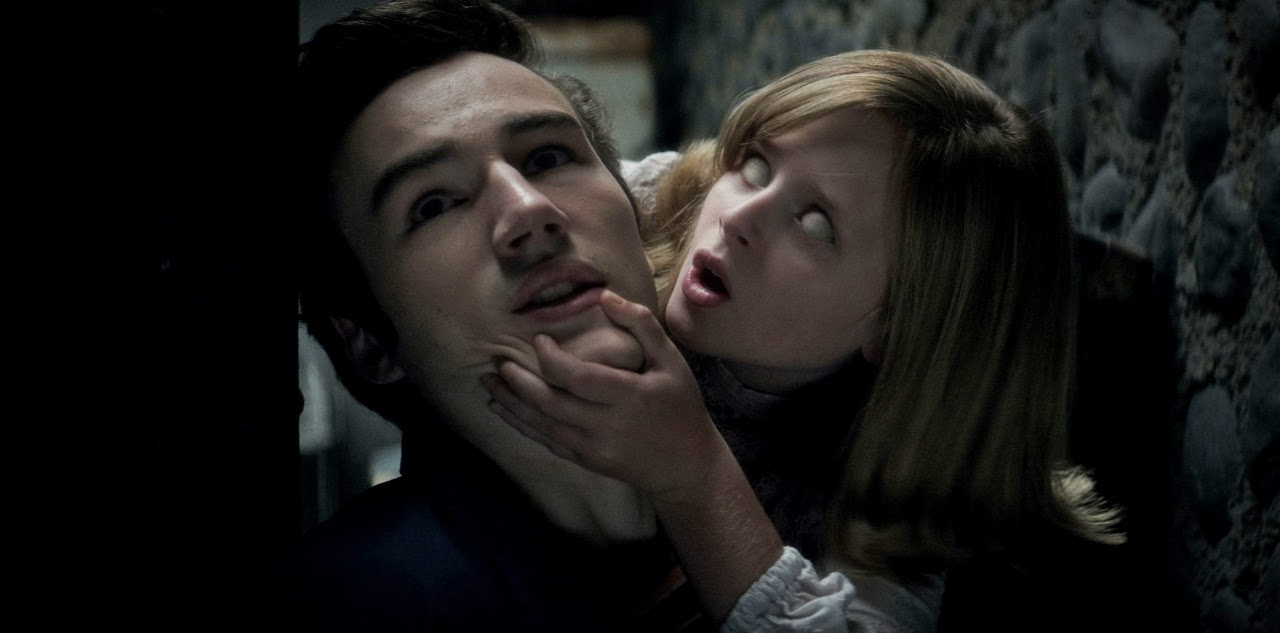 Parker Mack as Mikey and Lulu Wilson as Doris in OUIJA: ORIGIN OF EVIL. (Photo courtesy of Universal Pictures).