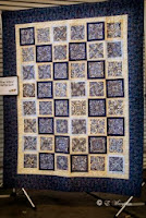"Congratulations to Therese Springer! She won the beautiful raffle quilt, ""Blue Willow"", donated by Jessie Comeaux."