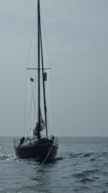 The 8m Dutch-registered yacht under tow by the ILB in Poole Bay - 23 July 2013.  Photo credit: RNLI/Poole