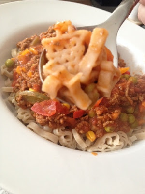 Gluten free organic brown rice pasta shapes with a bolognese sauce - Rachel Bustin