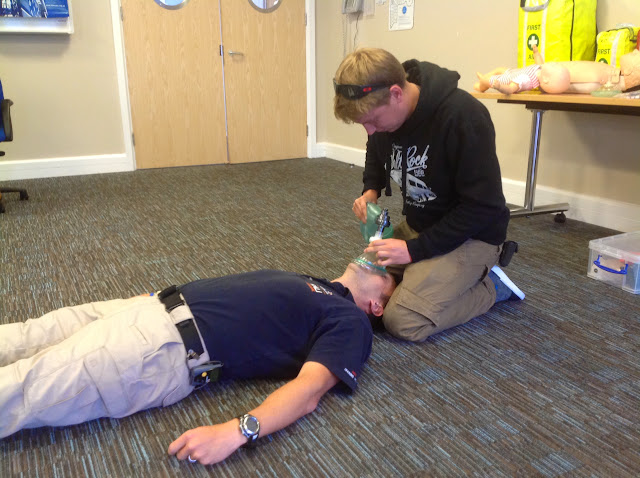 Crew Member Joe Manning carrying out assisted breathing using a bag, valve and mask on Casualty Care Trainer Grant Walkey - July 2014 Photo: Dave Riley