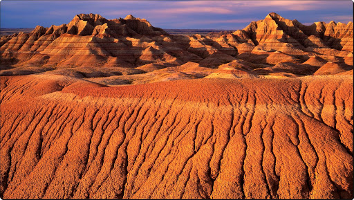 Morning Light on Eroded Formations, Badlands National Park, South Dakota.jpg
