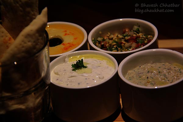 Hummus, Baba Ghanoush, Tabbouleh and Tzatziki served with Mediterranean Mezze Platter at Toss Sports Lounge Koregaon Park