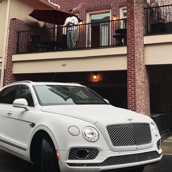 Davido Pictured With His New Bentley Bentayga In Front Of His Atlanta Home