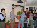 the Yunghe church giving a kumquat tree to the Ankeng church plant group