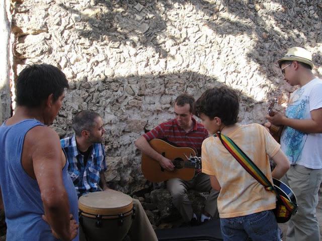 Joseph learned a bit of mandolin and ukulele at the outreach.