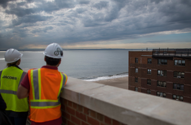 Workers at the Coney Island Houses in Brooklyn, where the New York City Housing Authority is spending $86.5 million on resiliency projects, including installing backup generators on rooftops. Photo: Joshua Bright / The New York Times