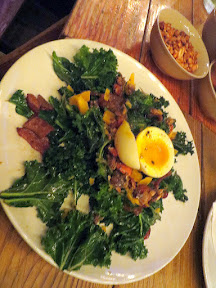 Brewstillery Festival preview of the StormBreaker Warm Kale salad with bacon, aged gouda, almond and seed brittle, soft egg, all in a balsamic brown butter dressing