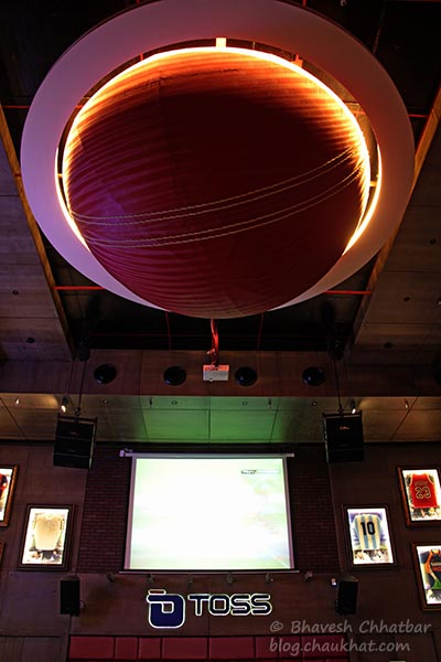 Lights on, on the huge cricket ball on the ceiling of Toss Sports Lounge Koregaon Park