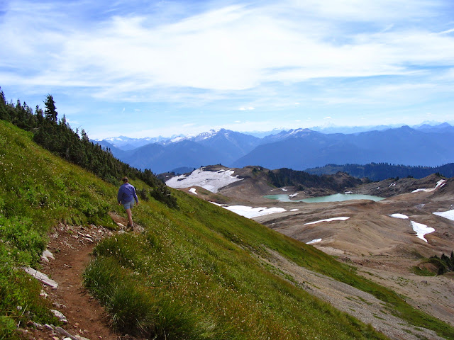 Begin in meadows, climb a bit to the snowy and rocky crest of a ridge open to the sky, and wander for miles on the high line toward the lofty white mass of Mt. Baker on the Ptarmigan Ridge Trail / Credit: Kern Nuttall